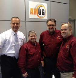 AMUG in SLM's stand at EuroMold. Pictured (left to right) are Stefan Ritt, Gary Rabinovitz, Graham Tromans and Kevin Ayers.