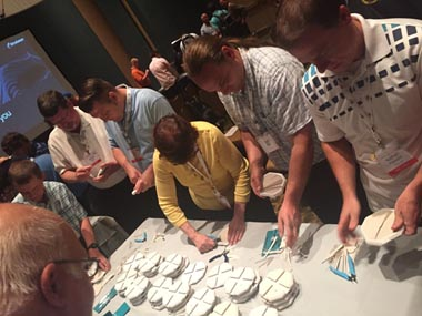 Attendees get hands on with finishing of FDM parts.